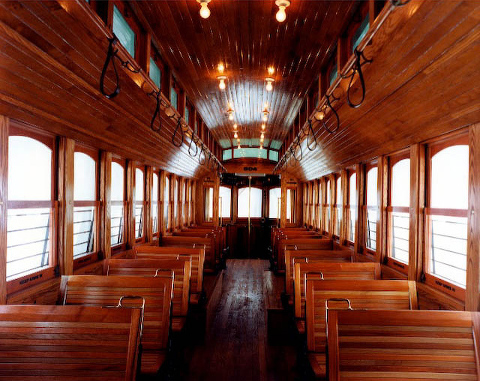Interior of trolly car with oak and cherry wood